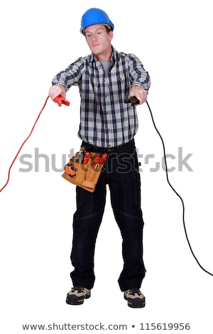 Stock photo: Electrician holding jumper cables