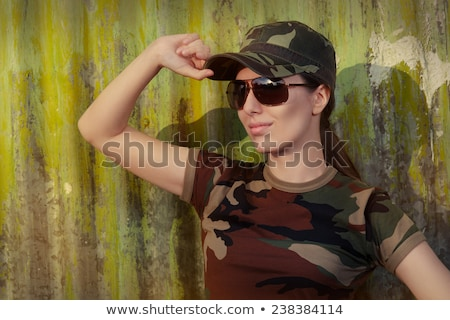 beauty fashion military confident woman in uniform saluting stock photo © gromovataya