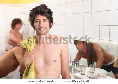 Three male housemates in bathroom Stock photo © photography33