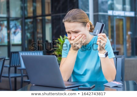 Horrified woman holding laptop Stock photo © photography33