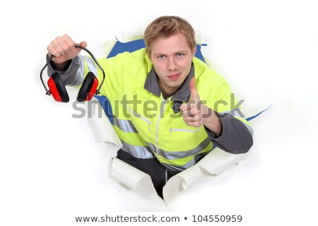 Worker giving the thumbs up to ear defenders Stock photo © photography33