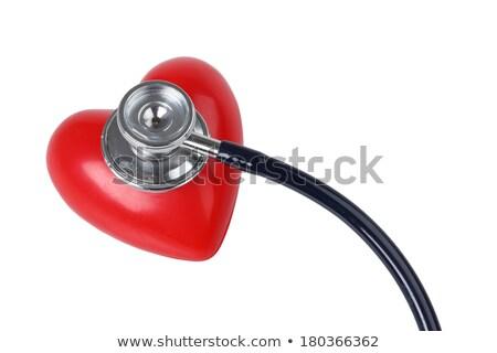 médico · escuchar · latido · del · corazón · feto · jóvenes · estetoscopio - foto stock © photography33