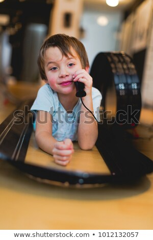 Little girl playing with scale model of housing Stock photo © photography33