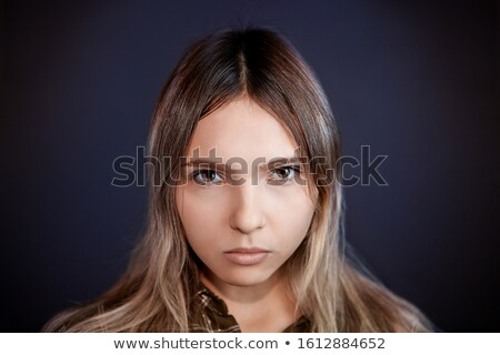 Young brown-haired woman with dark gaze Stock photo © photography33