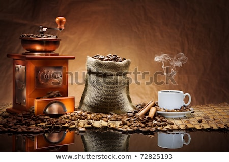 cup of coffee with an antique coffee mill stock photo © rogerashford
