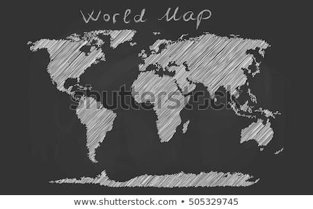 Foto stock: Esenhando · o · mapa · do · mundo · com · um · giz