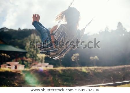 Kobieta huśtawka piękna zielone czerwony życia Zdjęcia stock © Andersonrise