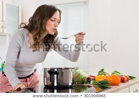Genç kadın tatma gıda mutfak ev kadın Stok fotoğraf © wavebreak_media