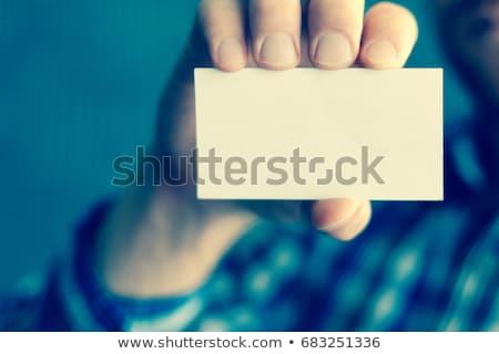 Férfi öltöny tart üres kártya kép üzlet Stock fotó © dolgachov