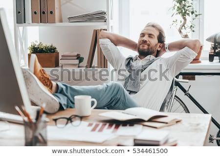 man at office with feet on the desk stock photo © courtyardpix