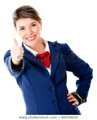 woman flight attendant with thumb up gesture stock photo © elnur