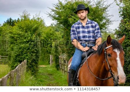 kaukázusi · férfi · cowboykalap · részben · arc · narancs - stock fotó © maridav
