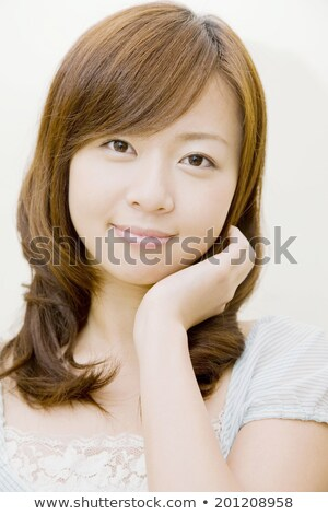 Delighted young woman stroking her face Stock photo © CandyboxPhoto