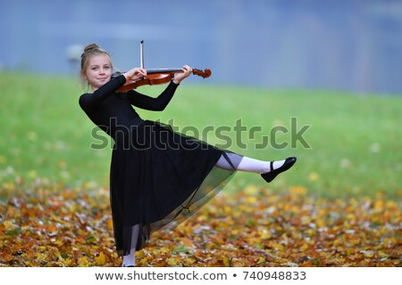Young violinist on swing Stock photo © nizhava1956