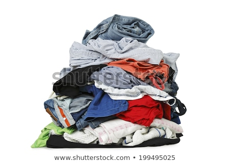 PIles of various clothes from laundry in a wardrobe Stock photo © photocreo