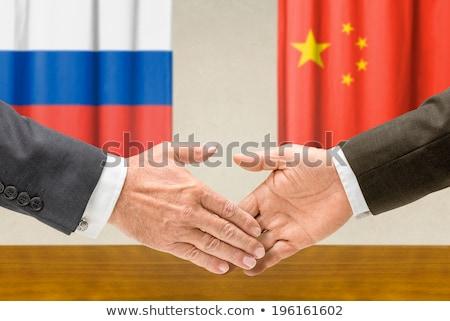 Representatives of Russia and China shake hands Stock photo © Zerbor