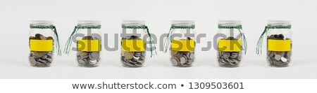монетами Jam банку воды деньги телефон Сток-фото © monkey_business