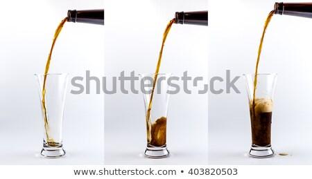Dark beer pouring Stock photo © hiddenhallow