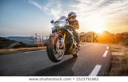 Motorfiets zonsondergang hemel man natuur straat Stockfoto © adrenalina
