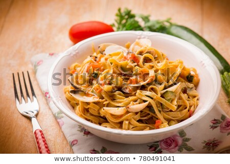 tagliatelle cooked with courgette and tomato Stock photo © M-studio