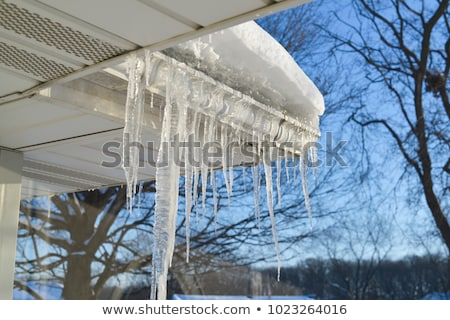 Icicles hanging off a roof Stock photo © smuki