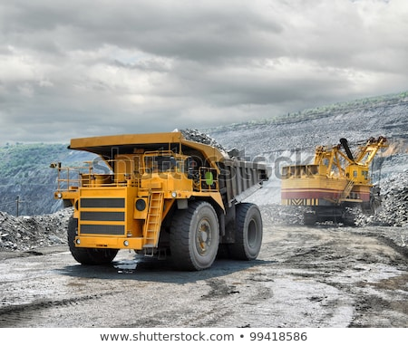 Stock photo: Loading of iron ore on very big dump body truck
