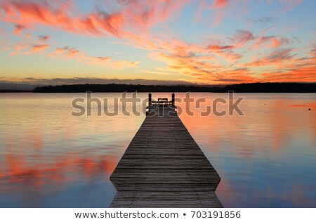 Sunset reflections on the waters of St Georges Basin Stock photo © lovleah