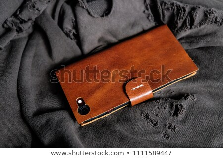 Teléfono móvil cuero caso aislado blanco teléfono Foto stock © gavran333