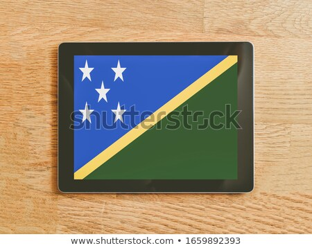 Tablet with Solomon Islands flag Stock photo © tang90246