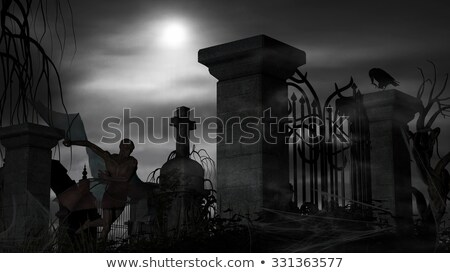 Vampire at a graveyard on a foggy night with full moon Stock photo © ankarb