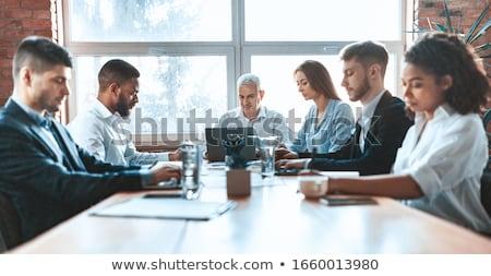 Fókuszált több nemzetiségű csoportkép dolgozik laptop együtt Stock fotó © deandrobot