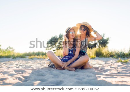 Portrait of two sisters having fun on the beach Stock photo © konradbak