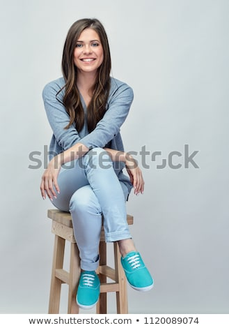 Woman with long legs sitting in a chair, isolated on white backg Stock photo © Nobilior