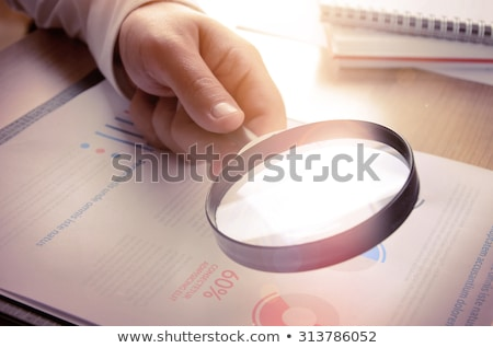 Business analytics and statistics using a magnifying glass Stock photo © stevanovicigor