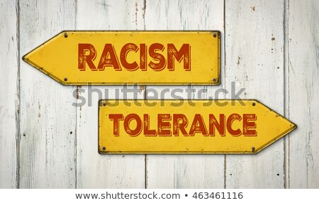 Direction signs on a wooden wall - Racism or Tolerance Stock photo © Zerbor