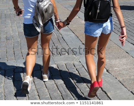 friends holding each others buttock stock photo © andreypopov