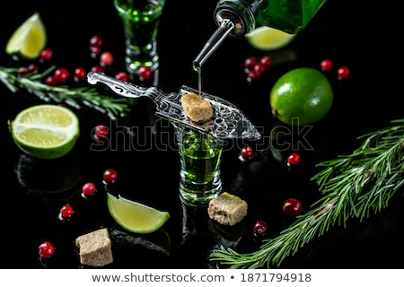 Stock photo: Glass of absinthe with lime and sugar cubes