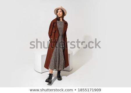 Genç esmer güzel kadın siyah elbise poz beyaz Stok fotoğraf © iordani
