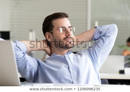 business man is resting on a chair and thinks  Stock photo © feedough
