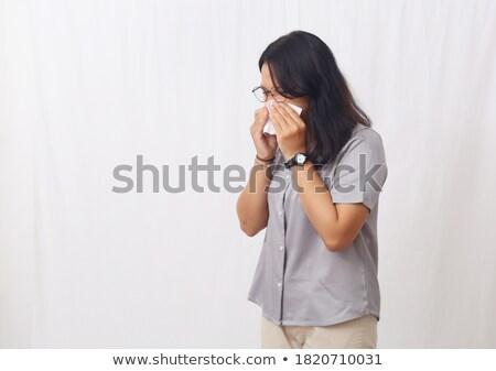 Fiatal ázsiai beteg nő orrot fúj papír Stock fotó © RAStudio