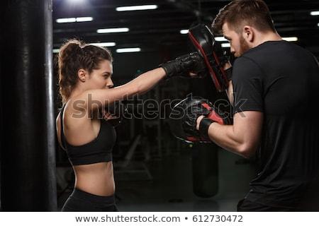концентрированный · молодые · спортивных · женщину · Боксер · изображение - Сток-фото © deandrobot