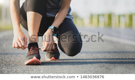 Stock photo: Runner trying running shoes getting ready for run