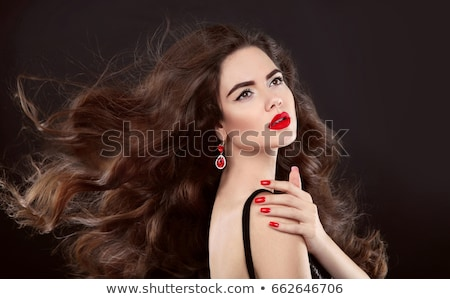 Elegant brunette woman. Fashion jewelry. Wavy hair style. Matte  Stock photo © Victoria_Andreas