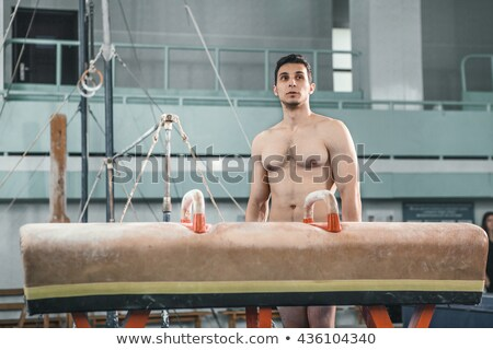 The sportsman before difficult exercise, sports gymnastics Stock photo © master1305
