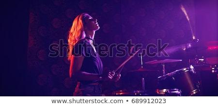 Stockfoto: Jonge · vrouwelijke · trommelaar · verlicht · discotheek