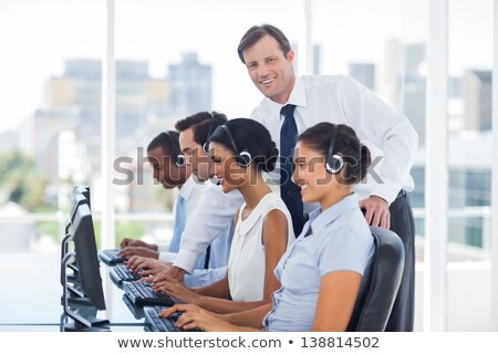 Portrait of supervisor with business team working at call center Stock photo © wavebreak_media