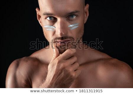 Pensive Man Stroking his Chin Stock photo © filipw