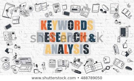 Multicolor Keywords Research and Analysis on White Brickwall.  Stock photo © tashatuvango