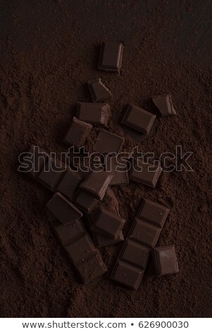 Top view of a dark chocolate bar crashed in pieces Stock photo © deandrobot