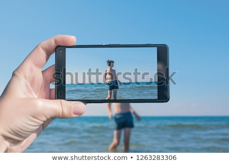 Stock photo: Family taking video by sea